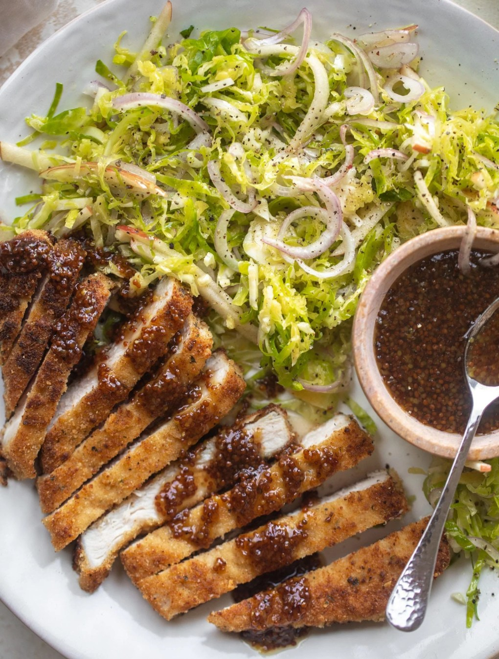 pork schnitzel with carolina gold BBQ sauce & brussels sprouts slaw