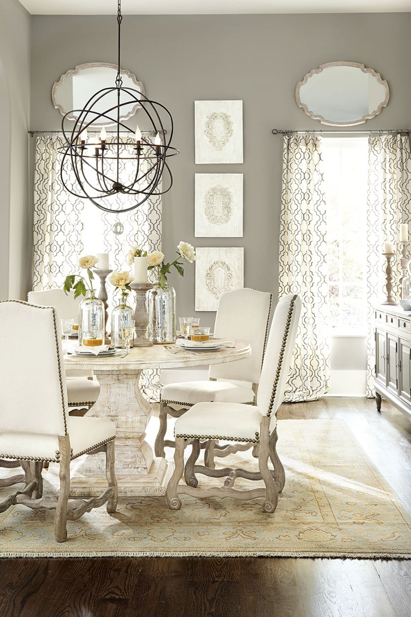 The use of fabrics on the chairs and windows, combined with the rug, are key to keeping conversations from