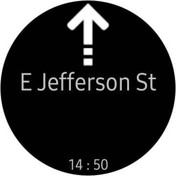 """An """"Awesome Navigator"""" direction to go straight to """"E Jefferson St"""" on a Samsung smartwatch screen."""