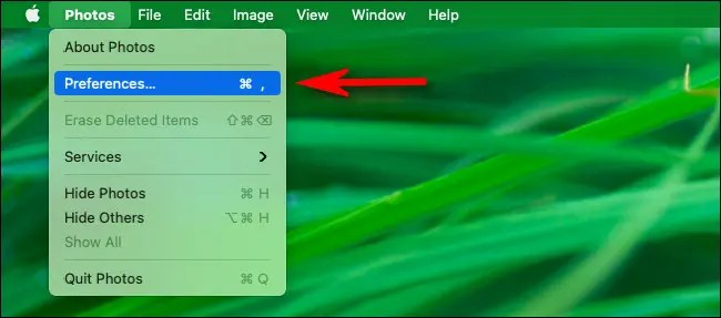 """In the menu bar, click """"Photos"""" then select """"Preferences"""" from the menu."""