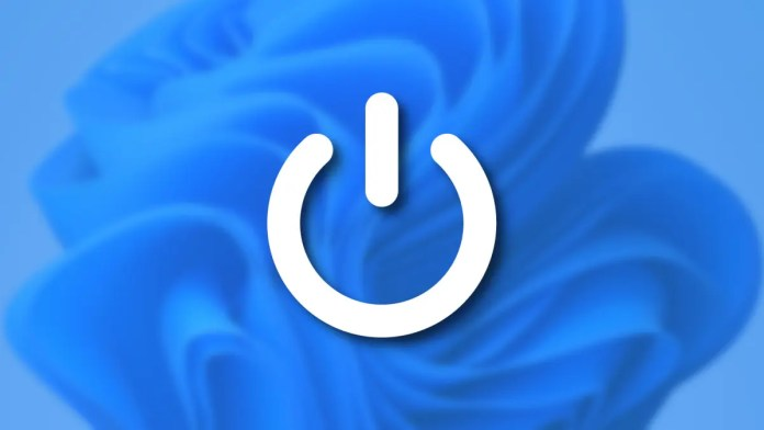 A power symbol over the Windows 11 background