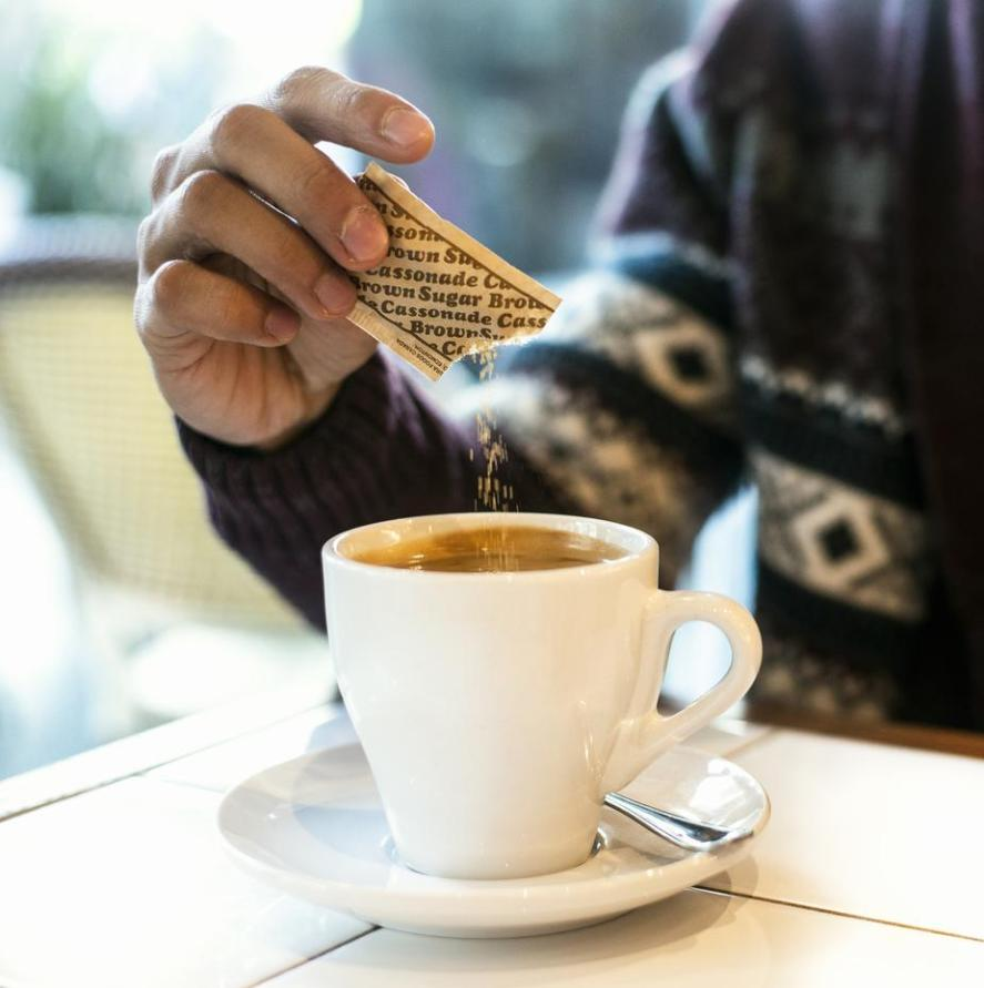 How to Recycle Sugar Packets - Sugar Being Added to Coffee