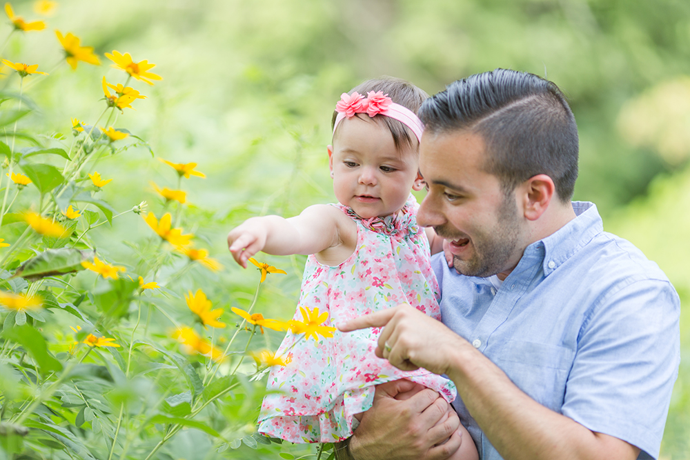 father and daughter with yellow flowers