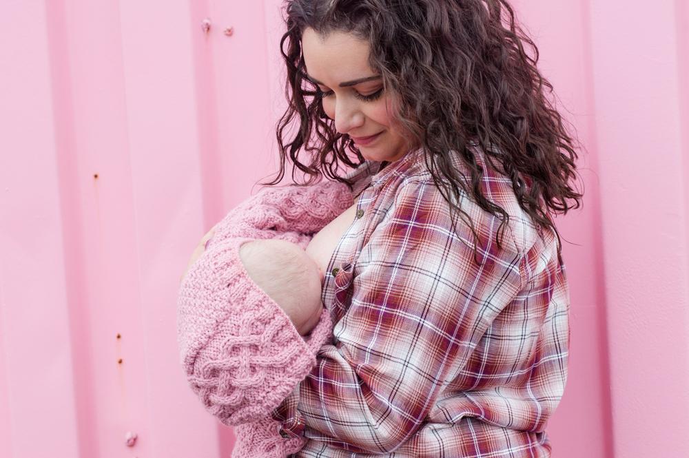 breastfeeding mom in pink