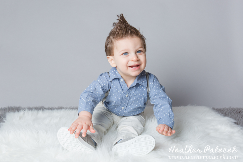 first birthday portrait of boy in blue button down
