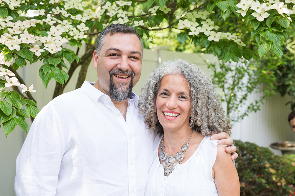 couple poses in backyard for portrait