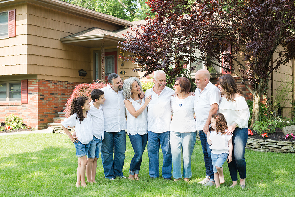 9 family members pose in front of grandparents house