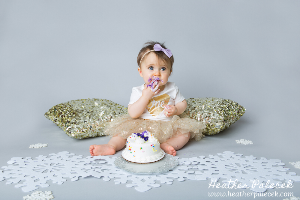 Snowflakes, Gold, and Purple 1st Birthday Cake Smash