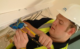 Electrical apprentice at work