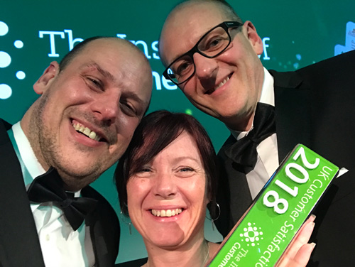 David Roberts (right), celebrates winning the ICS Customer Feedback Strategy Award with the company's head of operations, Steve Nixon (left), and HR manager, Nikki Terry (centre)