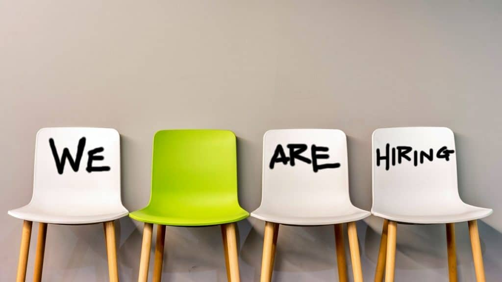 four chairs displaying the words we are hiring to discuss recruiting