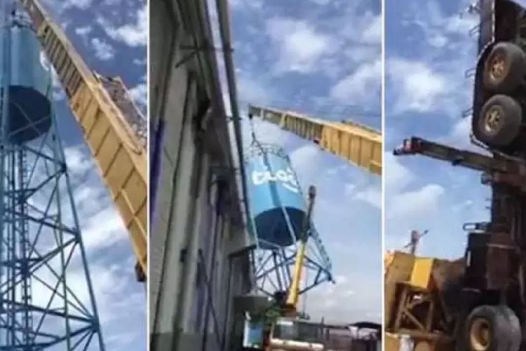 Moment Crane Topples Over As It's Overloaded By Water Tank
