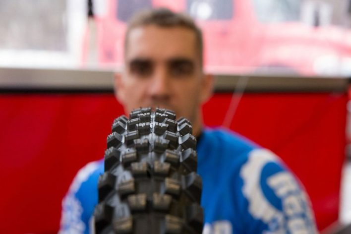 Sam Hill inspects a Michelin Wild Enduro tyre