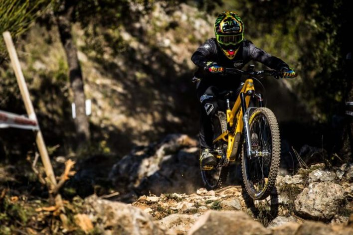 Sam Hill riding a bike equipped with a RockShox Zeb fork