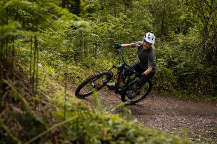 A mountain biker hitting a berm