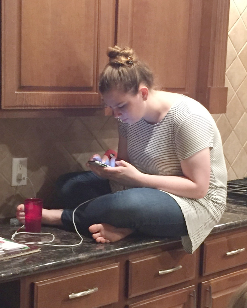 picture of girl sitting on kitchen counter