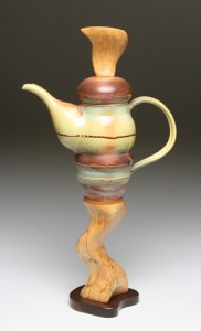 4. dark wood foot teapot