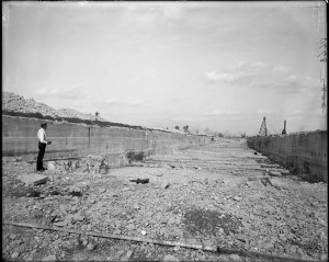"View of O.C. Farrington [verify], standing in the excavation site of the new Chicago Drainage [Sanitary and Ship] Canal. ""Construction proceeds on the Sanitary and Ship Canal...much of the 28 miles was through solid rock underlying the continental divide."" 1896. Original size and material: 4x5 inch glass negative Digital Identifier: CSGEO8770 Part of the Illinois Urban Landscapes Project: www.fieldmuseum.org/urbanlandscapes/"