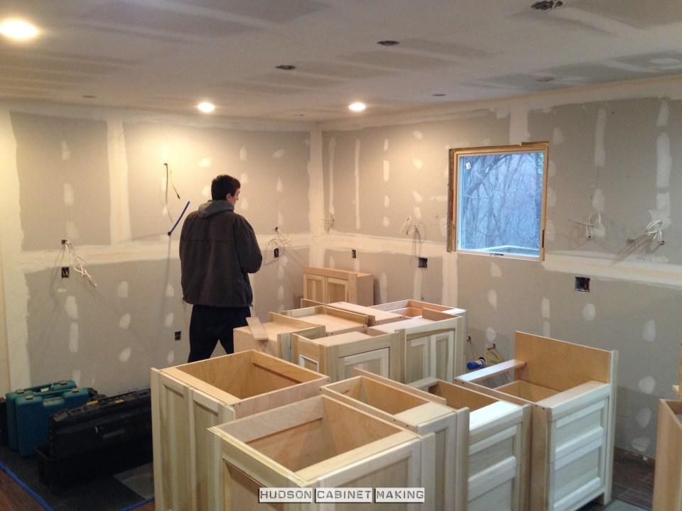 begin installing kitchen cabinets