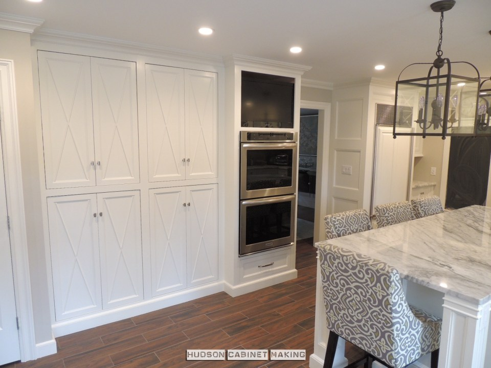 pantry, wall ovens and fridge surround