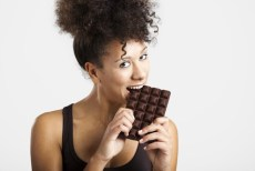 woman eats chocolate