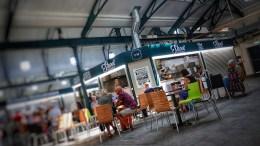 People dining inside Trinity Market