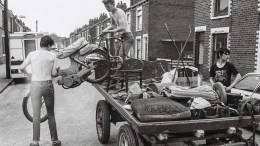 George Norris Jnr and Glen Collins loading a motorcycle onto a rulley in Stepney Lane, off Beverley Road, Hull. Picture: Russell Boyce