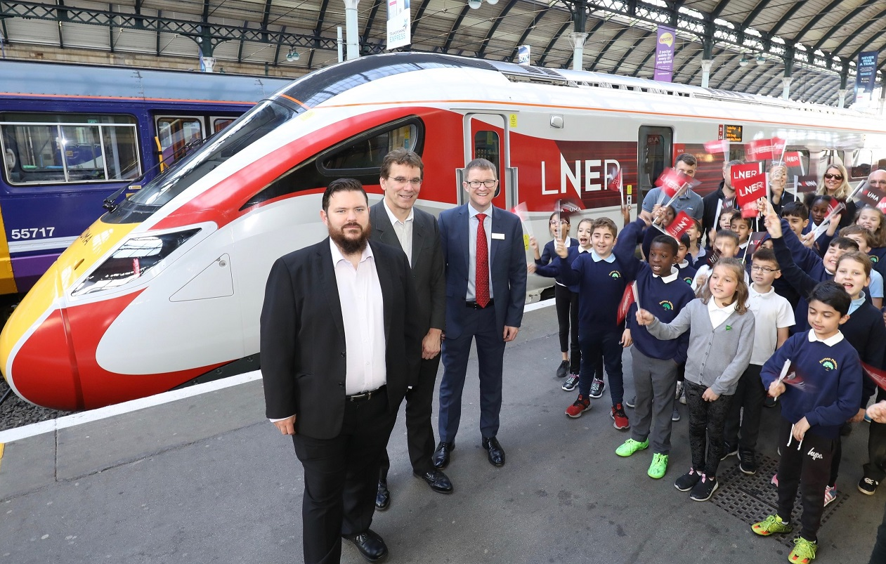 Garry Taylor, Hull City Council's city nanager for major projects and infrastructure, Cllr Daren Hale and LNER managing director David Horne with students and teachers from Pearson Primary, at the Azuma launch.