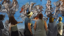 A group admires the spectacular, Last Judgement canvas replica by Michelangelo at the 13th century Great Hall in Winchester. © Zachary Culpin/Solent News and Photo Agency