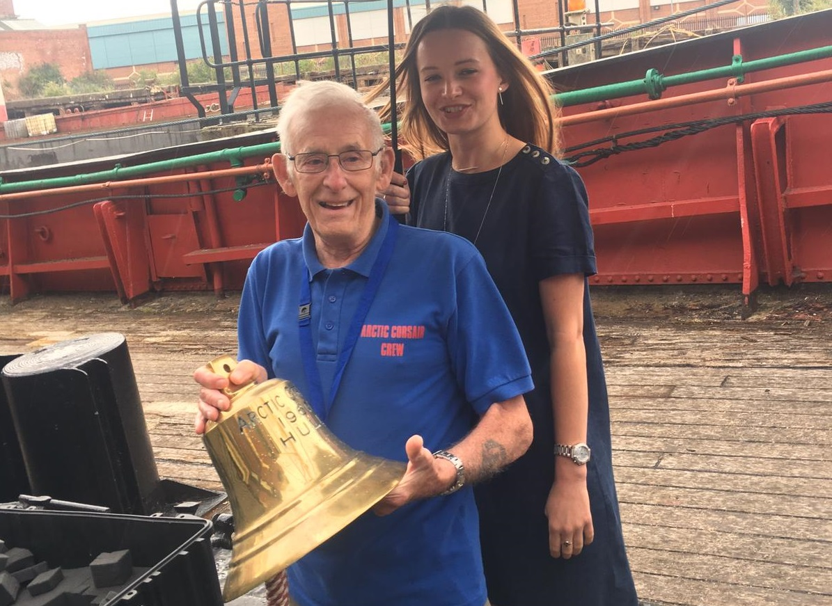 Trevor Evans, the longest-serving volunteer, and intern Abigail Jubb with the Arctic Corsair bell.