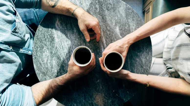 Two people meeting over coffee