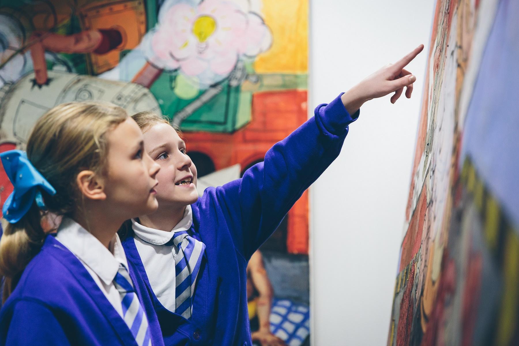 Children look at artwork