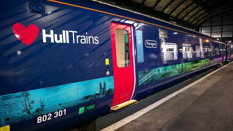 A train with the Hull Trains logo on the site