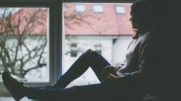 A woman sitting in a window