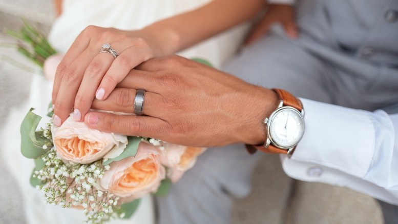 The hands of a bride and groom
