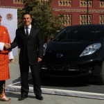 Tshering Tobgay Prime Minister of Bhutan with Nissan CEO Carlos Ghosn and Nissan Leaf electric car