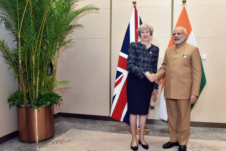 British Prime Minister Theresa May, right, and her Indian counterpart Narendra Modi