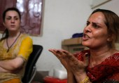 In this Tuesday, May 31, 2016 photo, Pakistani transgender guru Farzana, right, tells what happened to her colleague Alisha who was killed in Peshawar, Pakistan. Alisha was shot five times allegedly by her boyfriend who has since been arrested. She died of her wounds three days after being admitted to hospital. Her friends say she was neglected by doctors and medical professionals, who taunted her, rather than treated her. (AP Photo/Mohammad Sajjad)