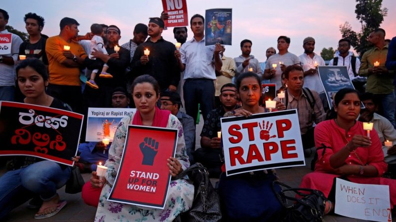 People participate in a candle light vigil as they protest against the rape of an 8-year-old girl in Kathua near Jammu, and a teenager in Unnao, Uttar Pradesh state, in Bengaluru, India on 13 April 2018
