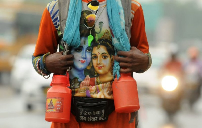 A Kanwariya seen wearing a t-shirt with the Hindu god Shiva printed on it.