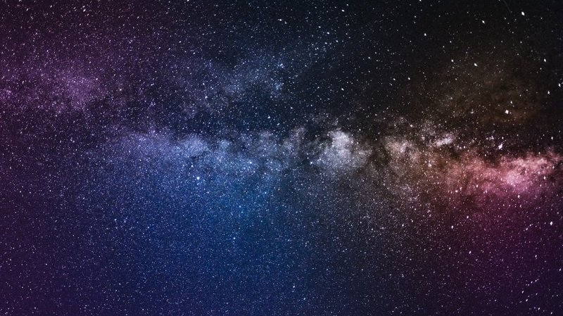 The universe - billions of bright stars, blue and purple, on a dark background