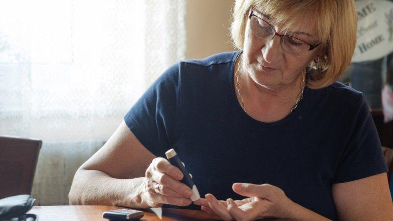 Woman testing blood sugars