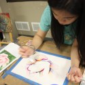 Girl learning to paint with watercolors