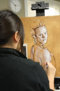 Art student sketching woman figure