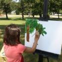 Little girl painting tree