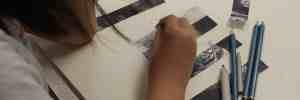 Girl drawing in sketchbook