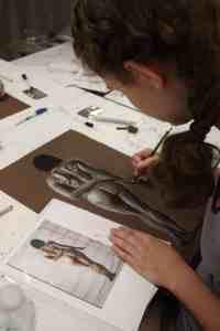 student drawing human figure