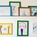 child's drawings displayed on wall at home