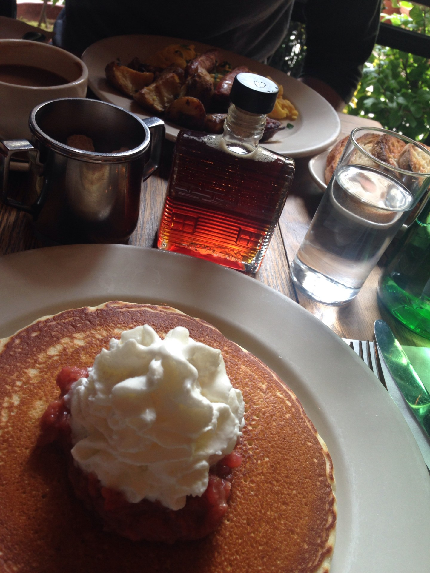 American pancakes with rhubarb compote, cream and maple syrup