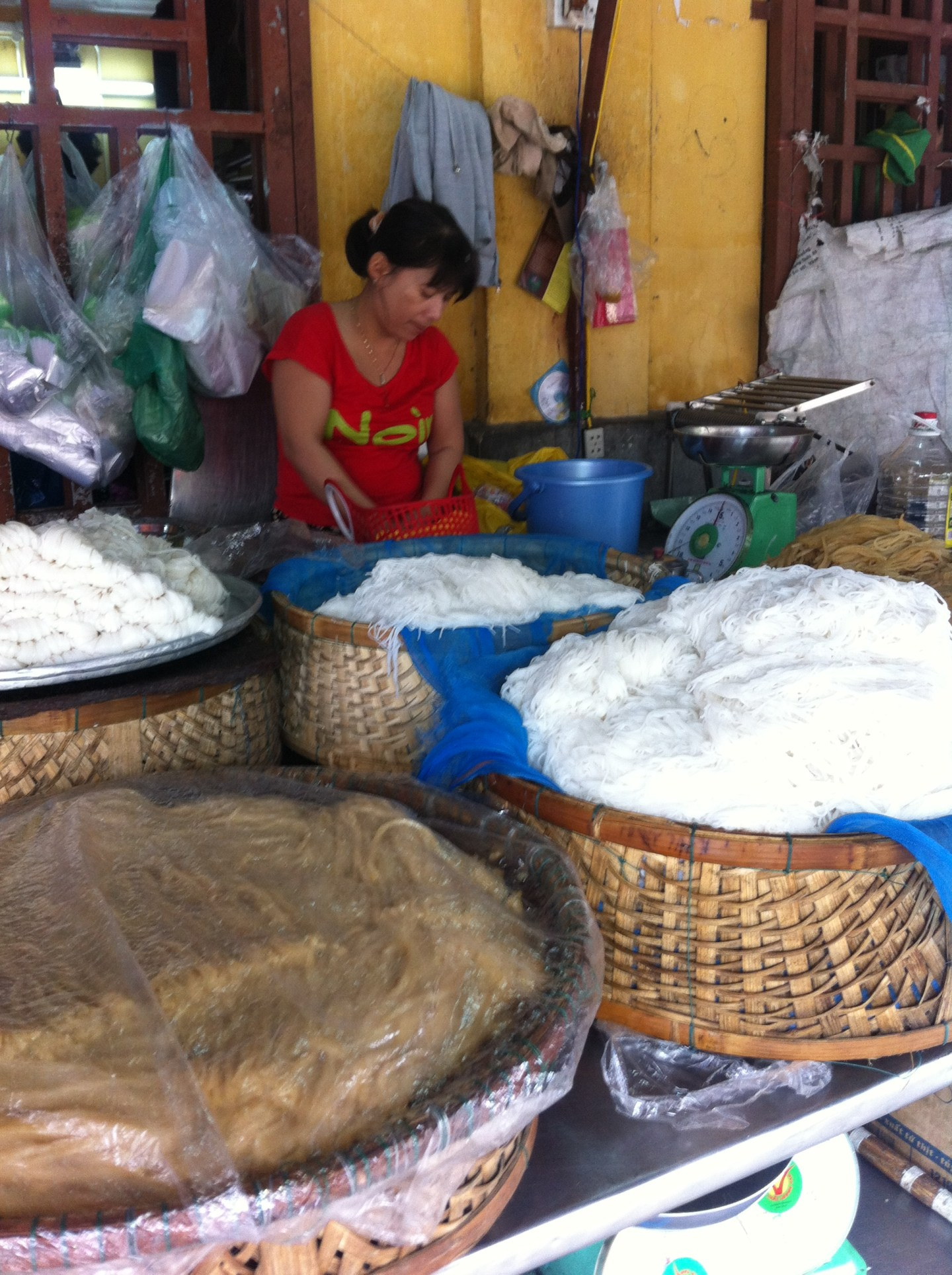 A woman making Cao Lao noodles in Hoi An